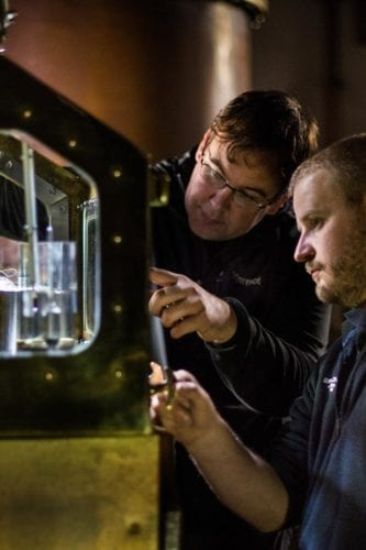 Production Director Allan Logan and Head Distiller Adam Hannett working on The Botanist at the spirit safe.
